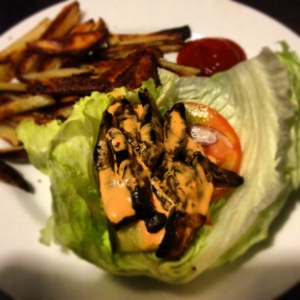 "Grilled Portobello Mushroom ""Burger"" with oven fries and roasted red pepper sauce."